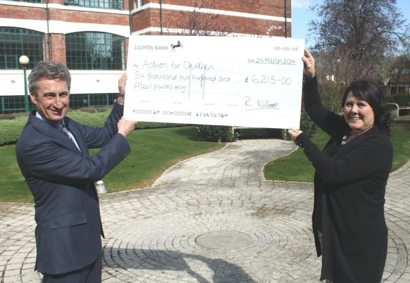 Rick Willmott presents a big cheque to Action for Children's Madeleine Clarke