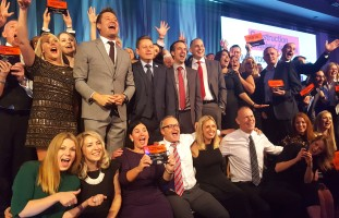 Image of CE awards on stage staff magazine.jpg